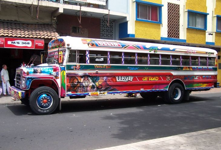Coloured city bus carrying passengers in Ecuador